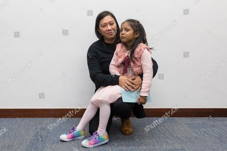 Filipino asylum seeker Vanessa Mae Bondalian Rodel, 40, and her daughter Kellepatha Sanuthi Keana Nihinsa, 5, pose for a photo after a press conference at the legislature in Hong Kong, China, 23 February 2017. Hong Kong pan-democrat legislators, Charles Mok and James To Kun-sun, and lawyer Robert Tibbo urged on the police to investigate claims that Sri Lankan Police Criminal Investigation Department officers were in Hong Kong looking for the asylum seekers from Sri Lanka who sheltered US whistle-blower Edward Snowden in 2013, the role of the refugees who sheltered Snowden for about two weeks was reported in September 2016. Snowden was reportedly sheltered in Hong Kong in 2013 by Sri Lankan asylum seekers Kellapatha Supun Thilina's family and Ajith Pushpakumara, and was also helped by Filipino asylum seeker Vanessa Mea.