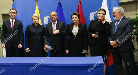 (l-r) Estonia Prime Minister Taavi Roivas Lithuanian President Dalia Grybauskaite European Commission President Jean Claude Juncker Prime Minister of Latvia Laimdota Straujuma and Poland's Prime Minister Ewa Kopacz Eu Commissioner in Charge of Climate and Energy Miguel Arias Canete During a Signature Ceremony For First Gas Interconnector Between Poland and Lithuania on the Side of Eu Summit in Brussels Belgium 15 October 2015 Eu Heads of State Or Government Will Focus on Migration the Completion of the Economic and Monetary Union and the State of Play on the British Referendum Are Also Topics to Be Discussed Belgium Brussels