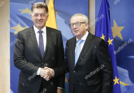 Lithuanian Prime Minister Algirdas Butkevicius is Welcomed by European Commission President Jean-claude Juncker (r) Prior to a Meeting at Eu Commission Headquarters in Brussels Belgium 19 November 2015 Belgium Brussels
