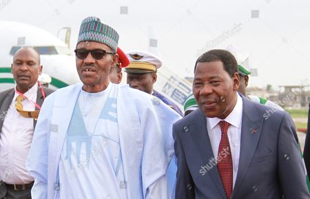President Yayi Boni (r) of Benin Alongside Nigerian President Muhammadu Buhari (l) As They Attend a Military Parade Marking the Countrys 55th Independence Anniversary in Cotonouh Benin 01 August 2015 the Nigerian President is on a One Day Visit to the Benin to Discuss the Regional Fight Against Boko Haram Benin Forms Part of a Multinational Joint Taskforce Against Boko Haram was Due to Be Launched Officially at the End of July 2015 Benin Cotonou