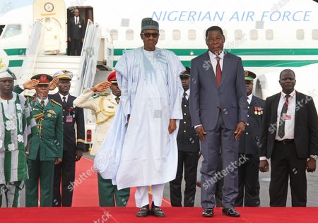 President Yayi Boni (c-r) of Benin Alongside Nigerian President Muhammadu Buhari ((c-l) As They Attend a Military Parade Marking the Countrys 55th Independence Anniversary in Cotonouh Benin 01 August 2015 the Nigerian President is on a One Day Visit to the Benin to Discuss the Regional Fight Against Boko Haram Benin Forms Part of a Multinational Joint Taskforce Against Boko Haram was Due to Be Launched Officially at the End of July 2015 Benin Cotonou