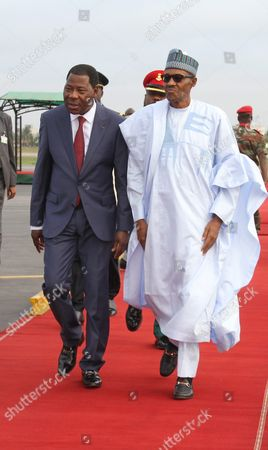 President Yayi Boni (l) of Benin Alongside Nigerian President Muhammadu Buhari (r) As They Attend a Military Parade Marking the Countrys 55th Independence Anniversary in Cotonouh Benin 01 August 2015 the Nigerian President is on a One Day Visit to the Benin to Discuss the Regional Fight Against Boko Haram Benin Forms Part of a Multinational Joint Taskforce Against Boko Haram was Due to Be Launched Officially at the End of July 2015 Benin Cotonou