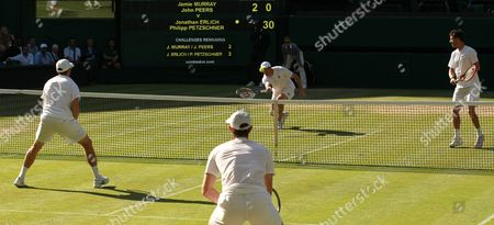 Philipp Petzschner (r) of Germany and Jonathan Erlich (c-back) of Israel in Action Against Jamie Murray of Britain and John Peers of Australia During the Men's Doubles Semi Final Match For the Wimbledon Championships at the All England Lawn Tennis Club in London Britain 09 July 2015 United Kingdom Wimbledon