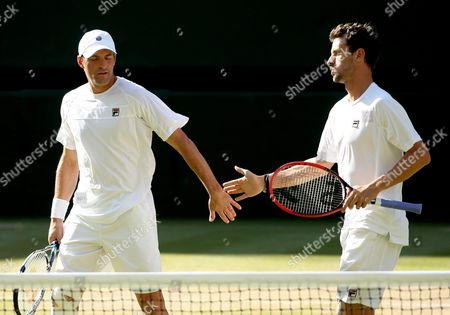Philipp Petzschner (r) of Germany and Jonathan Erlich of Israel in Action Against Jamie Murray of Britain and John Peers of Australia During the Men's Doubles Semi Final Match For the Wimbledon Championships at the All England Lawn Tennis Club in London Britain 09 July 2015 United Kingdom Wimbledon
