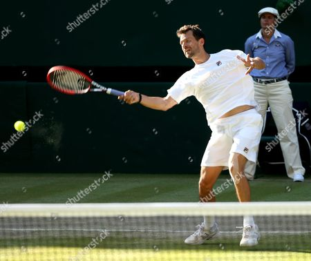 Philipp Petzschner of Germany in Action with Jonathan Erlich of Israel During the Men's Doubles Semi Final Match Against Jamie Murray of Britain and John Peers of Australia For the Wimbledon Championships at the All England Lawn Tennis Club in London Britain 09 July 2015 United Kingdom Wimbledon