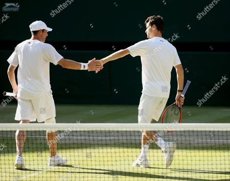 Stock Image of Jonathan Erlich (l) of Israel and Philipp Petzschner (r) of Germany in Action Against Jamie Murray of Britain and John Peers of Australia During Their Men's Doubles Semi Final Match For the Wimbledon Championships at the All England Lawn Tennis Club in London Britain 09 July 2015 United Kingdom Wimbledon