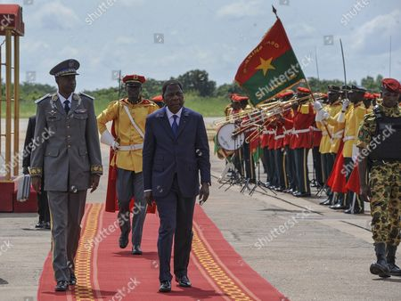 Burkina Faso Coup Leader General Gilbert Diendere (l) Walks with the President of Benin Yayi Boni (3-l) Shortly After His Arrival at the Airport in the Capital Ouagadougou Burkina Faso 23 September 2015 Burkina Faso Coup Leader General Gilbert Diendere who was Former President Blaise Compaore's Chief-of-staff Has Welcomed Several African Leaders who Have Arrived in Burkina Faso to Assist with the Transfer of Power Following the Coup Last Week the Presidential Guard Headed by General Gilbert Diendere Agreed to a Deal Overnight with the Regular Army to Avoid Violence General Gilbert Diendere Siezed Power in a Coup Last Week at Least Ten People Have Been Reported Killed with Around 100 Injured During Protests Between Presidential Guards and Protestors Opposed to the Coup Burkina Faso Ouagadougou