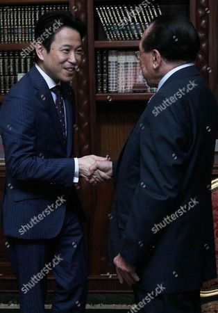 Japanese Deputy Minister of Foreign Affairs Masakazu Hamachi (l) Shakes Hands with Cambodian Deputy Prime Minister and Foreign Minister Hor Namhong (r) During a Meeting at the Ministry of Foreign Affairs and International Cooperation in Phnom Penh Cambodia 21 March 2016 the Government of Japan Granted 4 715 Million Yen (about 37 Million Euro) Aid to the Cambodia For Two Development Projects Cambodia Phnom Penh