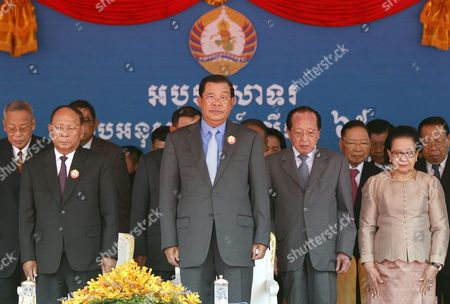 Cambodian Prime Minister Hun Sen (c) President of the National Assembly Heng Samrin (2-l) and Former Foreign Minister Hor Namhong (5-r) and His Wife (2-r) Listen to the National Anthem During a Ceremony in Phnom Penh Cambodia 28 June 2016 the Ruling Cambodian People's Party Marked the 65th Anniversary of Its Founding (28 June 1951) Prime Minister Hun Sen was Elected As a President of the Party After the Death of the Former President Chea Sim Cambodia Phnom Penh