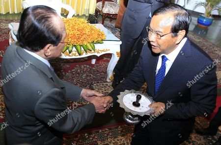 Newly Selected Cambodian Foreign Minister Prak Sokhon (r) Shakes Hands with Former Foreign Minister Hor Namhong (l) During a Ceremony at the Ministry of Foreign Affairs and International Cooperation in Phnom Penh Cambodia 05 April 2016 Prak Sokhon was Chosen As the New Cambodian Minister of Foreign Affairs and International Cooperation in a Reshuffling of the Cambodian Government Cambodia Phnom Penh