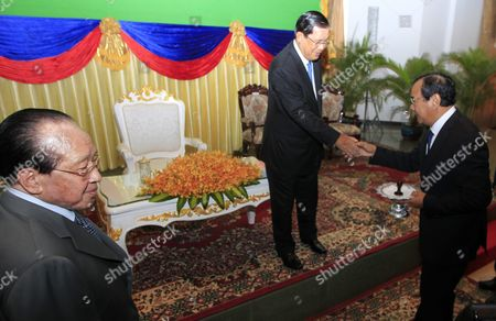 Cambodian Prime Minister Hun Sen (c) Shakes Hands with Newly Selected Cambodian Foreign Minister Prak Sokhon (r) As Former Foreign Minister Hor Namhong (l) Looks on During a Ceremony at the Ministry of Foreign Affairs and International Cooperation in Phnom Penh Cambodia 05 April 2016 Prak Sokhon was Chosen As the New Cambodian Minister of Foreign Affairs and International Cooperation in a Reshuffling of the Cambodian Government Cambodia Phnom Penh