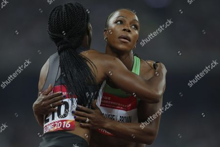 Veronica Campbell Brown (r) of Jamaica Hugs Simone Facey of Jamaica After Winning the Women's 200m Final of the Iaaf World Challenge at the Beijing National Stadium Also Known As the Bird's Nest Beijing China 18 May 2016 China Beijing