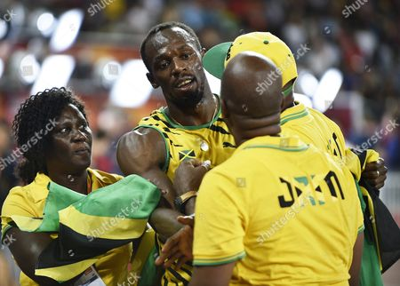 Jamaica's Usain Bolt (2nd L) Celebrates with His Mother Jennifer Bolt Father Wellesley Bolt and Manager Norman Peart (r Foreground) After Winning the Gold Medal in the Men's 100m Final During the Beijing 2015 Iaaf World Championships at the National Stadium Also Known As Bird's Nest in Beijing China 23 August 2015 China Beijing