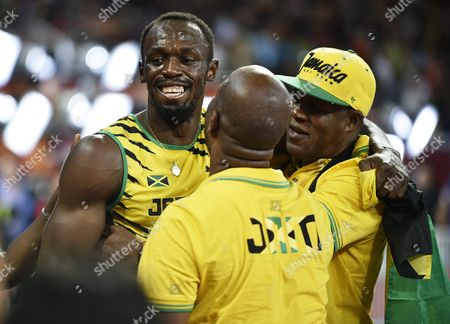 Jamaica's Usain Bolt (l) Celebrates with His Father Wellesley Bolt (r) and Manager Norman Peart After Winning the Gold Medal in the Men's 100m Final During the Beijing 2015 Iaaf World Championships at the National Stadium Also Known As Bird's Nest in Beijing China 23 August 2015 China Beijing