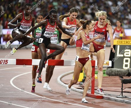 Habiba Ghribi (2nd R) of Turkey Emma Coburn (r) of the Us and Hyvin Kiyeng Jepkemoi of Kenya Competes in the Women's 3000m Steeplechase Final During the Beijing 2015 Iaaf World Championships at the National Stadium Also Known As Bird's Nest in Beijing China 26 August 2015 Jepkemoi Won and Ghribi Placed Second China Beijing