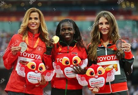 Kenya's Hyvin Kiyeng Jepkemoi (c) Poses with Her Gold Medal on the Podium After Winning the Women's 3 000m Steeplechase Final During the Beijing 2015 Iaaf World Championships at the National Stadium Also Known As Bird's Nest in Beijing China 27 August 2015 Jepkemoi Won Ahead of Second Placed Habiba Ghribi (l) of Turkey and Third Placed Gesa Felicitas Krause (r) of Germany China Beijing