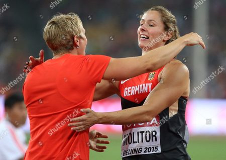 Germany's Katharina Molitor (r) Celebrates with Her Compatriot Christina Obergfoell (l) After Winning the Gold Medal in the Women's Javelin Throw Final During the Beijing 2015 Iaaf World Championships at the National Stadium Also Known As Bird's Nest in Beijing China 30 August 2015 China Beijing