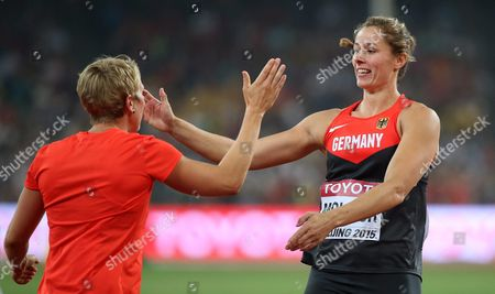 Stock Image of Germany's Katharina Molitor (r) Celebrates with Her Compatriot Christina Obergfoell (l) After Winning the Gold Medal in the Women's Javelin Throw Final During the Beijing 2015 Iaaf World Championships at the National Stadium Also Known As Bird's Nest in Beijing China 30 August 2015 China Beijing