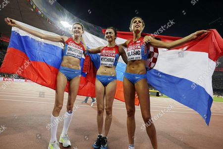 Russia's Maria Kuchina (c) Celebrates After Winning the Gold Medal in the Women's High Jump Final of the Beijing 2015 Iaaf World Championships at the National Stadium Also Known As Bird's Nest in Beijing China 29 August 2015 Kuchina Won Ahead of Second Placed Blanka Vlasic (r) of Croatia and Third Placed Anna Chicherova (l) of Russia China Beijing