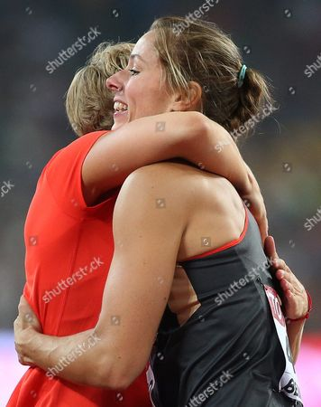 Stock Photo of Germany's Katharina Molitor (r) Celebrates with Her Compatriot Christina Obergfoell (l) After Winning the Gold Medal in the Women's Javelin Throw Final During the Beijing 2015 Iaaf World Championships at the National Stadium Also Known As Bird's Nest in Beijing China 30 August 2015 China Beijing