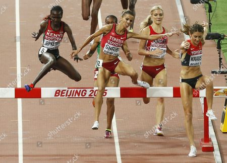 Hyvin Kiyeng Jepkemoi (l) of Kenya Habiba Ghribi (c) of Turkey and Gesa Felicitas Krause (r) Germany Compete in the Women's 3000m Steeplechase Final During the Beijing 2015 Iaaf World Championships at the National Stadium Also Known As Bird's Nest in Beijing China 26 August 2015 China Beijing