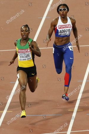 Veronica Campbell-brown (l) of Jamaica and Margaret Adeoye of Great Britain Compete in the Women's 200m Heats During the Beijing 2015 Iaaf World Championships at the National Stadium Also Known As Bird's Nest in Beijing China 26 August 2015 China Beijing