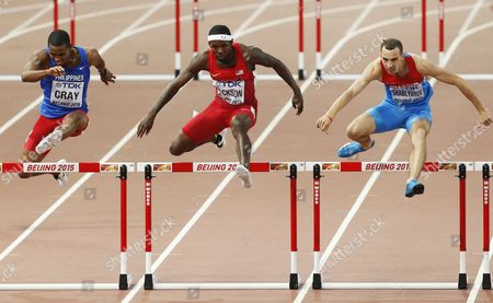 (from Left) Eric Cray of the Philippines Bershawn Jackson of the Us and Ivan Shablyuyev of Russia in Action During Men's 400m Hurdles Heats During the Beijing 2015 Iaaf World Championships at the National Stadium Also Known As Bird's Nest in Beijing China 22 August 2015 China Beijing
