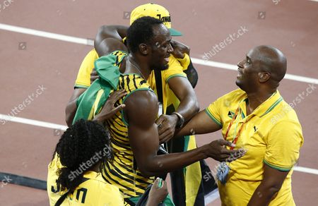 Jamaica's Usain Bolt Celebrates with His Mother Jennifer Bolt and Manager Norman Peart (r) After Winning the Gold Medal in the Men's 100m Final During the Beijing 2015 Iaaf World Championships at the National Stadium Also Known As Bird's Nest in Beijing China 23 August 2015 China Beijing