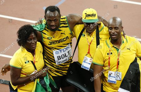 Jamaica's Usain Bolt (2nd L) Celebrates with His Mother Jennifer Bolt Father Wellesley Bolt and Manager Norman Peart (r) After Winning the Gold Medal in the Men's 100m Final During the Beijing 2015 Iaaf World Championships at the National Stadium Also Known As Bird's Nest in Beijing China 23 August 2015 China Beijing