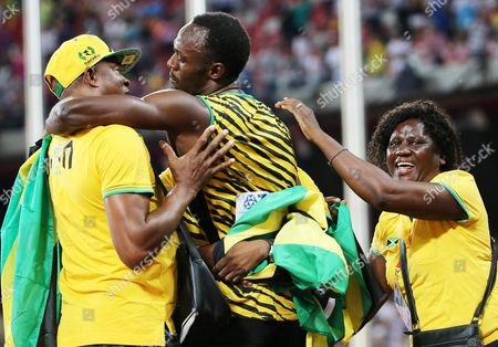 Jamaica's Usain Bolt (c) Celebrates with His Mother Jennifer Bolt and Father Wellesley Bolt After Winning the Gold Medal in the Men's 100m Final During the Beijing 2015 Iaaf World Championships at the National Stadium Also Known As Bird's Nest in Beijing China 23 August 2015 China Beijing