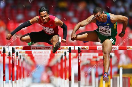 Stock Image of Lac Jamras Rittidet (l) of Thailand and Eder Antonio Souza of Brazil Compete in the Men's 110m Hurdles Heats During the Beijing 2015 Iaaf World Championships at the National Stadium Also Known As Bird's Nest in Beijing China 26 August 2015 China Beijing