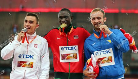 David Rudisha (c) of Kenya Poses with His Gold Medal on the Podium After Winning the Men's 800m Final During the Beijing 2015 Iaaf World Championships at the National Stadium Also Known As Bird's Nest in Beijing China 26 August 2015 Rudisha Won Ahead of Second Placed Adam Kszczot (l) of Poland and Third Placed Amel Tuka (r) of Bosnia & Herzegovina China Beijing