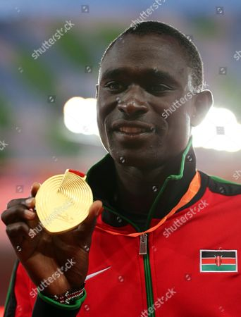 David Rudisha of Kenya Poses with His Gold Medal on the Podium After Winning the Men's 800m Final During the Beijing 2015 Iaaf World Championships at the National Stadium Also Known As Bird's Nest in Beijing China 26 August 2015 China Beijing