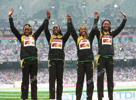 Jamaica's (from Left) Elaine Thompson Veronica Campbell-brown Shelly-ann Fraser-pryce and Natasha Thompson Wave to Spectaors During the Medal Ceremony For the Women's 4x100m Relay Final During the Beijing 2015 Iaaf World Championships at the National Stadium Also Known As Bird's Nest in Beijing China 30 August 2015 China Beijing