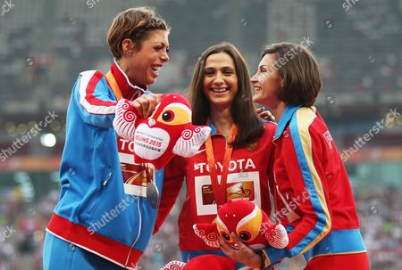 Russia's Maria Kuchina (c) Poses with Her Gold Medal on the Podium After Winning the Women's High Jump Final of the Beijing 2015 Iaaf World Championships at the National Stadium Also Known As Bird's Nest in Beijing China 30 August 2015 Kuchina Won Ahead of Second Placed Blanka Vlasic (l) of Croatia and Third Placed Anna Chicherova (r) of Russia China Beijing