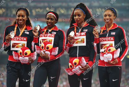 Silver Medal Winners Usa's (from Left) Sanya Richards-ross Natasha Hastings Francena Mccorory and Allyson Felix on the Podium During the Medal Ceremony For the Women's 4x400m Relay Final During the Beijing 2015 Iaaf World Championships at the National Stadium Also Known As Bird's Nest in Beijing China 30 August 2015 China Beijing