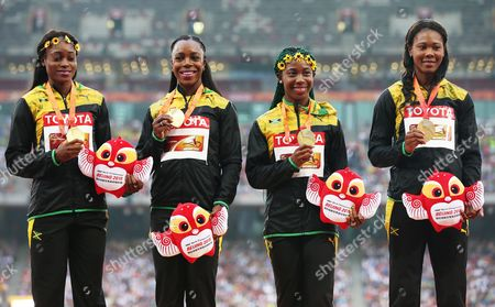 Jamaica's (from Left) Elaine Thompson Veronica Campbell-brown Shelly-ann Fraser-pryce and Natasha Thompson Pose with Their Gold Medals During the Medal Ceremony For the Women's 4x100m Relay Final During the Beijing 2015 Iaaf World Championships at the National Stadium Also Known As Bird's Nest in Beijing China 30 August 2015 China Beijing