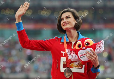 Russia's Anna Chicherova Celebrates on the Podium After Winning the Bronze Medal in the Women's High Jump Final of the Beijing 2015 Iaaf World Championships at the National Stadium Also Known As Bird's Nest in Beijing China 30 August 2015 China Beijing