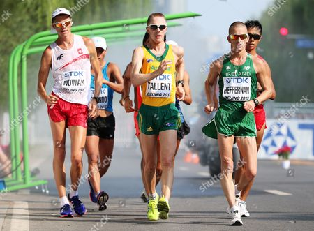Jared Tallent of Australia; Robert Heffernan of Ireland and Lukasz Nowak Poland Compete in the Men's 50km Walk Race During the Beijing 2015 Iaaf World Championships at the National Stadium Also Known As Bird's Nest in Beijing China 29 August 2015 China Beijing
