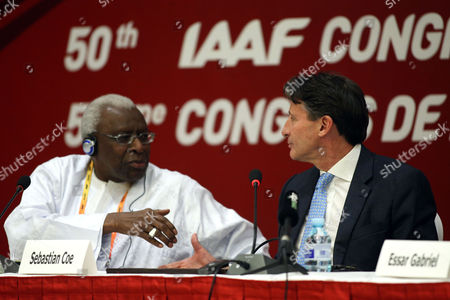 Former Iaaf President Lamine Diack (l) and Former British Olympic Medalist Sebastian Coe Shake Hands As They Attend Iaaf Press Conference After Winning the Iaaf Elections at China National Convention Centre in Beijing China 19 August 2015 Coe 58 Has Been Elected President of the Ruling Athletics Body International Association of Athletics Federations (iaaf) on 19 August 2015 Beating Ukraine's Sergey Bubka 115-92 Coe Succeeds Senegal's Lamine Diack who is Stepping Down After 16 Years in Office China Beijing