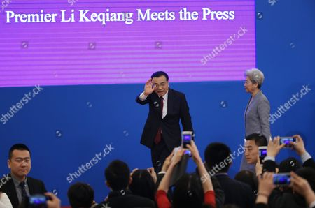 Chinese Premier Li Keqiang (c) Waves As He Leaves the Stage with Fu Ying (r) Spokesperson For the Fourth Session of the 12th National People's Congress (npc) After His Press Conference at the Great Hall of the People in Beijing China 16 March 2016 China Beijing