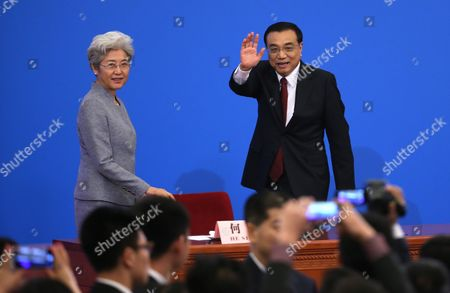 Chinese Premier Li Keqiang (r) Waves As He Leaves the Stage with Fu Ying (l) Spokesperson For the Fourth Session of the 12th National People's Congress (npc) After His Press Conference at the Great Hall of the People in Beijing China 16 March 2016 China Beijing