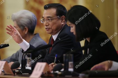 Chinese Premier Li Keqiang (c) Flanked by Fu Ying (l) Spokesperson For the Fourth Session of the 12th National People's Congress (npc) and an Interpreter Speaks to Reporters During His Press Conference After the Closing of the Fourth Session of the 12th National People's Congress (npc) at the Great Hall of the People in Beijing China 16 March 2016 China Beijing