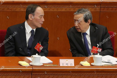 Secretary of the Central Commission For Discipline Inspection Wang Qishan (l) and Chinese Vice Premier Ma Kai (r) Talk During the 2nd Plenary Session of the Fourth Session of the 12th National People's Congress (npc) at the Great Hall of the People in Beijing China 09 March 2016 the Npc Has Over 3 000 Delegates and is the World's Largest Parliament Or Legislative Assembly Though Its Function is Largely As a Formal Seal of Approval For the Policies Fixed by the Leaders of the Chinese Communist Party China Beijing