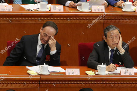 Secretary of the Central Commission For Discipline Inspection Wang Qishan (l) and Chinese Vice Premier Ma Kai (r) Attend the 2nd Plenary Session of the Fourth Session of the 12th National People's Congress (npc) at the Great Hall of the People in Beijing China 09 March 2016 the Npc Has Over 3 000 Delegates and is the World's Largest Parliament Or Legislative Assembly Though Its Function is Largely As a Formal Seal of Approval For the Policies Fixed by the Leaders of the Chinese Communist Party China Beijing
