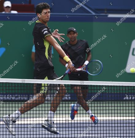 Raven Klaasen (behind) of South Africa and Marcelo Melo (front) of Brazil in Action Against Simone Bolelli of Italy and Fabio Fognini of Italy During the Doubles Final Match in the Shanghai Tennis Masters at the Qi Zhong Tennis Center in Shanghai China 18 October 2015 China Shanghai