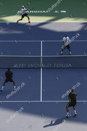 Simone Bolelli of Italy and Fabio Fognini of Italy (top) in Action Against Raven Klaasen of South Africa and Marcelo Melo of Brazil (bottom) During the Doubles Final Match in the Shanghai Tennis Masters at the Qi Zhong Tennis Center in Shanghai China 18 October 2015 China Shanghai