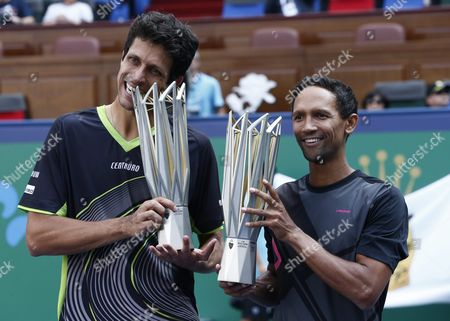 Raven Klaasen (r) of South Africa and Marcelo Melo (l) of Brazil Hold Their Championship Trophies After Winning Their Doubles Final Match Against Simone Bolelli of Italy and Fabio Fognini of Italy in the Shanghai Tennis Masters at the Qi Zhong Tennis Center in Shanghai China 18 October 2015 China Shanghai