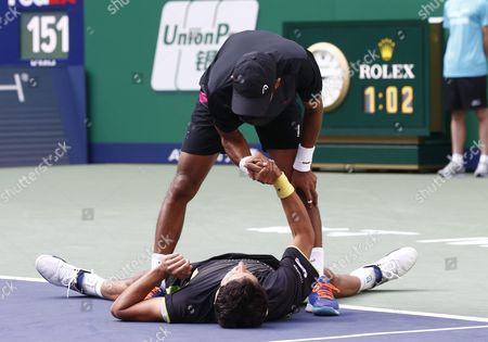 Raven Klaasen (top) of South Africa Congratulates Marcelo Melo (bottom) of Brazil Celebrate After Their Doubles Final Match Against Simone Bolelli of Italy and Fabio Fognini of Italy in the Shanghai Tennis Masters at the Qi Zhong Tennis Center in Shanghai China 18 October 2015 China Shanghai