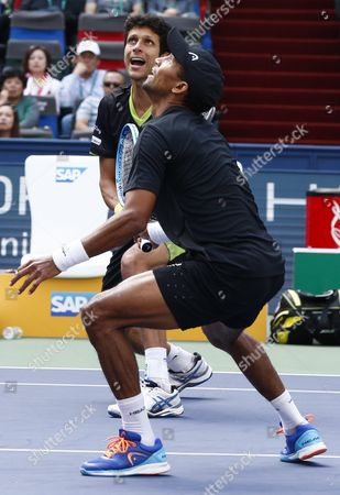 Raven Klaasen (front) of South Africa and Marcelo Melo (behind) of Brazil in Action Against Simone Bolelli of Italy and Fabio Fognini of Italy During the Doubles Final Match in the Shanghai Tennis Masters at the Qi Zhong Tennis Center in Shanghai China 18 October 2015 China Shanghai